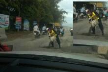 แห่ชื่นชมตำรวจจราจรน้ำดี ขนหินถมถนนกันอุบัติเหตุ