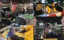 ประชาชนนอนฝ่าฝนจับจองพื้นที่โดยรอบถนนราชดำเนินใน เฝ้ารองานพระราชพิธี