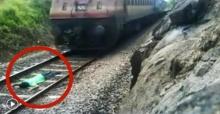 สุดหวาดเสียว!! หนุ่มท้าความตาย ถ่ายคลิปโชว์นอนกลางราง ให้รถไฟวิ่งผ่านร่าง!! (มีคลิป)