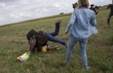 ผู้สื่อข่าวฉาวขัดขาผู้อพยพ...ฟ้องกลับหลังทำเธอตกงาน!!(คลิป)